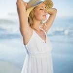Woman in a sunhat basking in the sun